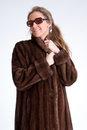 Girl wearing fur and sunglasses young woman a mink coat Royalty Free Stock Image