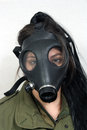 Girl wearing a gas mask young woman and military olive drab jacket Stock Photo