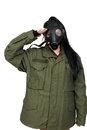 Girl wearing a gas mask young woman and military olive drab jacket isolated on white background Royalty Free Stock Photography