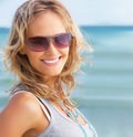 Girl wearing goggles smiling at the beach Stock Photography
