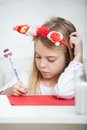 Girl wearing headband writing letter to santa cute claus at home Royalty Free Stock Photo