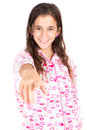 Girl wearing pajamas and pointing a finger at the camera hispanic isolated on white Stock Photos