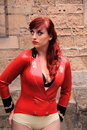 Girl wearing red latex dress Royalty Free Stock Photography