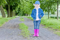 Girl wearing rubber boots Stock Photo