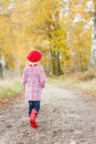 Girl wearing rubber boots Royalty Free Stock Image