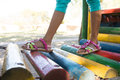 Girl wearing sandal walking on jungle gym Royalty Free Stock Photo