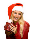 Girl wearing santa claus hat Royalty Free Stock Images