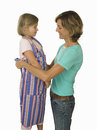 Girl wearing striped apron mother tying knot smiling cut out Stock Image