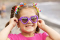 Girl wearing a sunglasses on the beach summer holidays funny little Royalty Free Stock Images