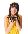 Girl wearing yellow dress with a gift box Royalty Free Stock Photos