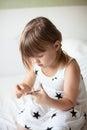 Girl weaves jewelry bracelet gum gum plaiting band weaving hobby on a light background Stock Image