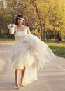 Girl in a wedding dress beautiful walking down the street ada ciganlija belgrade Stock Photo
