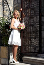 Girl in a wedding dress at the gate Stock Images