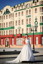 Girl in a wedding dress replica of old building facade belgrade Stock Photo