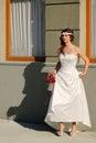 Girl in a wedding dress replica of old building facade belgrade Royalty Free Stock Photo