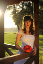 Girl in a wedding dress and sunsete the park ada ciganlija belgrade Stock Photo