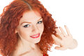 Girl with a welcoming gesture beautiful red hair welcomes his hand Royalty Free Stock Photo