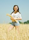 Girl  with  wheat ear Royalty Free Stock Images