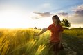 Girl on wheat fieald teenage in field likes a crop Royalty Free Stock Image
