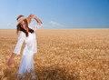 Girl on wheat field Royalty Free Stock Image