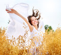Girl on the Wheat Field Royalty Free Stock Photo