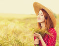Girl at wheat field Royalty Free Stock Photo