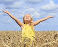 Girl in wheat field a stretching his arms to the sky Royalty Free Stock Photography