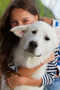 Girl with white alaskan malamute dog portrait of a her Stock Photos