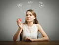 Girl in white and apple Royalty Free Stock Photo
