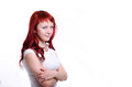 Girl on white background red haired a looking at you Stock Photo