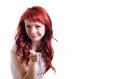 Girl on white background red haired a looks and points a finger at you Royalty Free Stock Photos