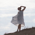 Girl in white on background of sky Royalty Free Stock Photo