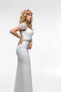 Girl in a white dress athena fashion portrait of beautiful women with blond hair elegant on background Royalty Free Stock Photography