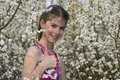 Girl with white flowers showing ok laughing small around her in the nature collection Stock Photography
