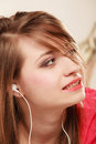 Girl with white headphones listening to music woman student learning language new technology Stock Photo
