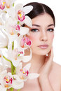Girl with white orchid Royalty Free Stock Photo