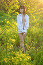 image photo : Girl in a white shirt on a glade