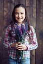 Girl with wildflowers cute holding bunch of Royalty Free Stock Image