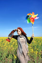 Girl with wind turbine and lamp at rape field. Stock Image