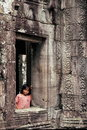 Girl at window, Angkor Wat, Cambodia Royalty Free Stock Photo