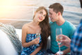Girl with wineglass and guy. Royalty Free Stock Photo