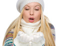 Girl in winter clothes blowing snow isolated on white Royalty Free Stock Photo