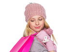 Girl in winter clothes with christmas shopping bag isolated on white Stock Image