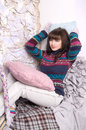 Girl winter clothes in a cozy interior Royalty Free Stock Photo