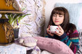 Girl in winter clothes drinking tea Stock Image