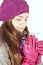 Girl in winter clothes holding cup of warm cure Stock Images