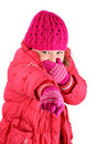 Girl in winter clothes laughing pointing a finger Royalty Free Stock Photo