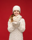 Girl in winter clothes with something on palms seasonal people happiness concept smiling Royalty Free Stock Photography
