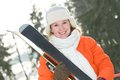 Girl at winter clothing with skis pretty smiling young in warm forest outdoors Stock Images
