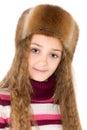 The girl in a winter fur-cap Royalty Free Stock Photos